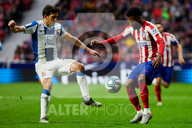 Thomas Lemar of Atletico de Madrid and Javi Lopez of RCD Espanyol during La Liga match between Atletico de Madrid and RCD Espanyol at Wanda Metropolitano Stadium in Madrid, Spain. November 10, 2019. (ALTERPHOTOS/A. Perez Meca)