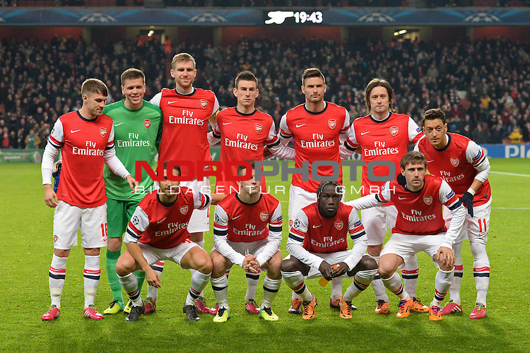 26.11.2013, Emirates Stadium London, UEFA Champions League, Arsenal FC  vs  Olympique Marseille, Gruppenphase, Pool E, im Bild <br /> <br /> Team Arsenal , re Mesut Oezil (&radic;Ėzil) und Per Mertesacker<br /> <br /> Foto nph / Gunn