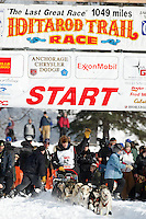 Dallas Seavey waves to the crowd as he leaves the start line on Sunday during the restart day of Iditarod 2009 in Willow , Alaska