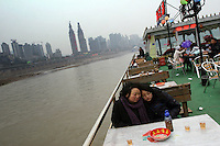 CHINA. Sichuan Province. Chongqing. Mother and daughter on a tourist boat on The Yangtze River which is at its lowest level in 150 years as a result of a country-wide drought. Chongqing is a city of over 3,000,000 people, famed for being the capital of China between 1938 and 1946 during World War II. It is situated on the banks of the Yangtze river, China's longest river and the third longest in the world. Originating in Tibet, the river flows for 3,964 miles (6,380km) through central China into the East China Sea at Shanghai.  2008.