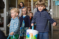 """NWA Democrat-Gazette/CHARLIE KAIJO Kids race outside to begin an egg hunt, Sunday, March 25, 2018 at Cooper Elementary in Bella Vista. <br /><br />Northwest Community Church hosted a Palm Sunday egg hunt at Cooper Elementary where they also hold Sunday worship.<br /><br />""""We are using this as an opportunity to reach out and serve the community,"""" said <br />Family and Missions Pastor Scott Sanders. """"A lot of people are doing Easter egg hunts next week and we wanted to do something a little different.""""<br /><br />""""We're not a church with an actual building. We want people to know we exist. We have that as a purpose and we also just want to serve the community,"""" he added."""