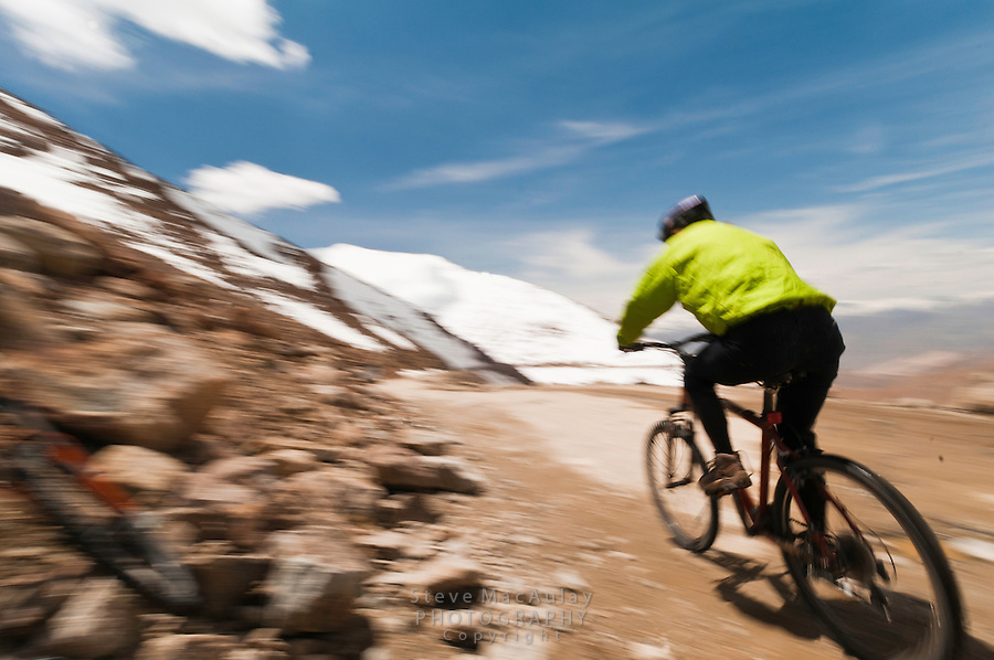 Dynamic motion photo of mountain biking on the highest motorable road in the world,  Himalayan Mountains, Ladakh, India.