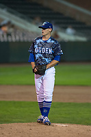 Ogden Raptors relief pitcher Wes Helsabeck (27) prepares to deliver a pitch during a Pioneer League game against the Billings Mustangs at Lindquist Field on August 17, 2018 in Ogden, Utah. The Billings Mustangs defeated the Ogden Raptors by a score of 6-3. (Zachary Lucy/Four Seam Images)