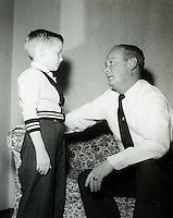 Father and son having a talk. 1950's.