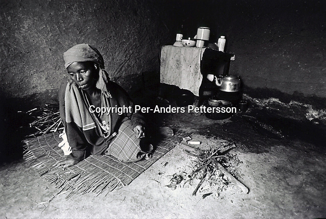 NQBENI, SOUTH AFRICA - FEBRUARY 25:  Margarette Shenge, age 39, sits on the floor in her home on February 25, 2002 in Nqbeni, in southern Natal province in South Africa. The Aids virus infects her and her husband died of the disease in 1997. Two of her four children are also infected. She recently accepted that she is sick, and can't work or take care of her children anymore. Zethu, age, and the oldest daughter have run away to Durban with a boyfriend living the mother in this rural area with no help. South Africa has one of the highest growth rates of HIV Aids in the world and is fighting hard to educate the population on safe sex practices and the importance of abstinence for young people..Photo: Per-Anders Pettersson/ iAfrika Photos..