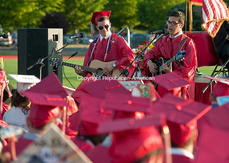 WOLCOTT, CT-062414JS06--Wolcott graduates Michael Slebnick and Nicholas Ciarlo perform &quot;Risk it All&quot;, a song they co-wrote,  during graduation ceremonies held Tuesday at Wolcott High School. <br /> Jim Shannon Republican-American