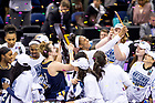 April 1, 2018; Players take a selfie withe the championship trophy following the Women's Basketball Final Four Championship Game. Notre Dame defeated Mississippi State 61-58. (Photo by Matt Cashore/University of Notre Dame)