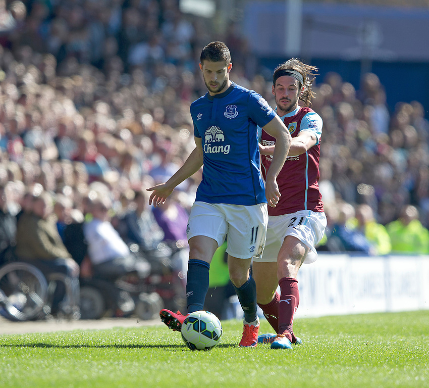 Everton's Kevin Mirallas shields the ball from Burnley's George Boyd<br /> <br /> Photographer Stephen White/CameraSport<br /> <br /> Football - Barclays Premiership - Everton v Burnley - Saturday 18th April 2015 - Goodison Park - Everton<br /> <br /> &copy; CameraSport - 43 Linden Ave. Countesthorpe. Leicester. England. LE8 5PG - Tel: +44 (0) 116 277 4147 - admin@camerasport.com - www.camerasport.com