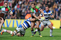 Nick Evans of Harlequins looks for support as he is tackled by Alafoti Fa'osiliva of Bath Rugby during the Aviva Premiership match between Harlequins and Bath Rugby at The Twickenham Stoop on Saturday 10th May 2014 (Photo by Rob Munro)