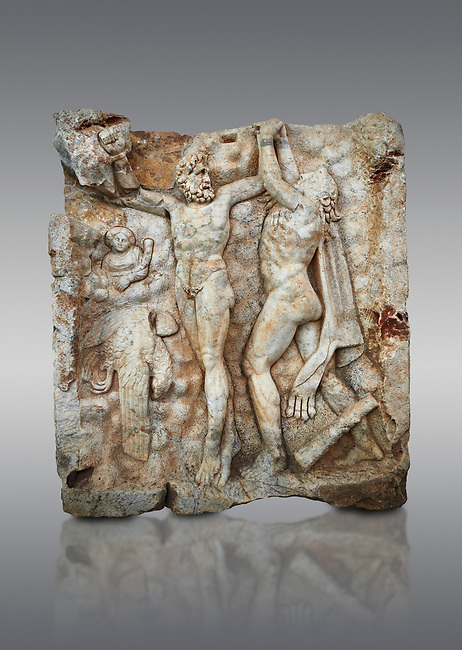 Roman Sebasteion relief sculpture of Zeus and Prometheus, Aphrodisias Museum, Aphrodisias, Turkey.  <br /> <br /> Prometheus is screaming in pain. Zeus had given him a terrible punishment for giving fire to man: he was tied to the Caucasus mountains and had his liver picked out daily by an eagle. Herakles shot the eagle and is undoing the first manacle. He wears his trade mark lion-skin and thrown his club to one side. A small mountain nymph, holding a throwing stick appears amongst the rocks.