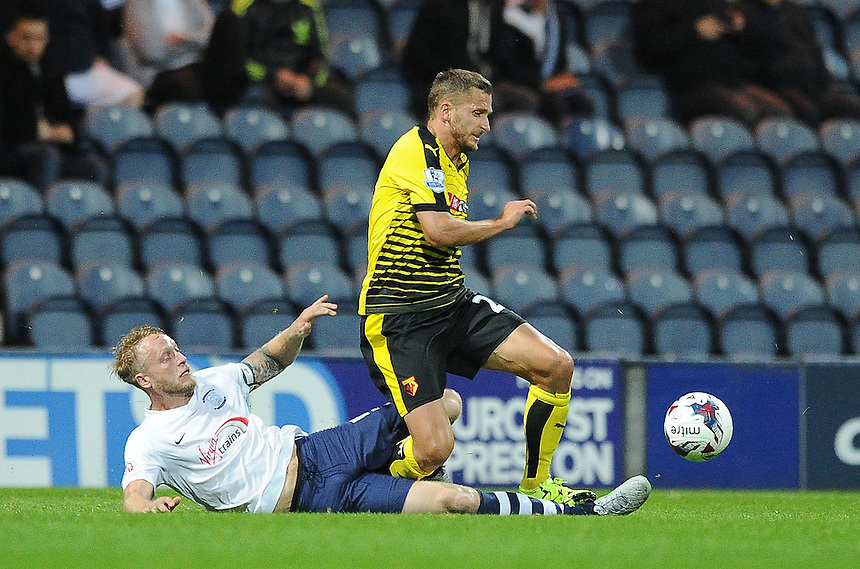 Watford's Almen Abdi is tackled by  Preston North End's Tom Clarke<br /> <br /> Photographer Dave Howarth/CameraSport<br /> <br /> Football - Capital One Cup Second Round - Preston North End v Watford - Tuesday 25 August 2015 - Deepdale - Preston<br />  <br /> &copy; CameraSport - 43 Linden Ave. Countesthorpe. Leicester. England. LE8 5PG - Tel: +44 (0) 116 277 4147 - admin@camerasport.com - www.camerasport.com