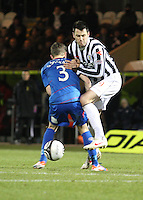 Steven Thompson tackled by Graeme Shinnie in the St Mirren v Inverness Caledonian Thistle Clydesdale Bank Scottish Premier League match played at St Mirren Park, Paisley on 30.1.13.
