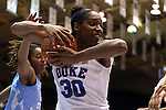 24 January 2016: Duke's Amber Henson (30) grabs a rebound away from North Carolina's N'Dea Bryant (22). The Duke University Blue Devils hosted the University of North Carolina Tar Heels at Cameron Indoor Stadium in Durham, North Carolina in a 2015-16 NCAA Division I Women's Basketball game. Duke won the game 71-55.