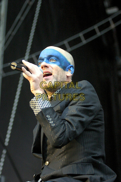MICHAEL STIPE - R.E.M..Perform live in concert at Nottingham Forrest Football Club, Nottingham, July 6th 2005..half length gig REM FC  blue face paint make-up .Ref: JEZ.www.capitalpictures.com.sales@capitalpictures.com.©Jez Self/Capital Pictures