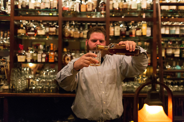 May 8, 2015. Chapel Hill, North Carolina.<br />  Bartender Christian Madsen pours a glass of Old Scout 10 Year bourbon.<br />  The Crunkleton, located on Franklin Street, specializes in fine cocktails and with its massive selection of liquors and highly trained bartenders, they can suit almost any taste.<br />  Outsiders tend to lump Chapel Hill with nearby Durham, but the more sensible pairing is with Carrboro, the adjacent town that was once a mere offshoot known as West End. Even today the transition from Chapel Hill, anchored by North Carolina''s flagship public university, into downtown Carrboro is virtually seamless.