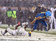 Philadelphia, PA - December 9, 2017:    Navy Midshipmen running back Malcolm Perry (10) stumbles during the 118th game between Army vs Navy at Lincoln Financial Field in Philadelphia, PA. (Photo by Elliott Brown/Media Images International)