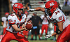 Hunter Hassett #12, Center Moriches quarterback, left, hands off to Nathan Sigerson #24 during a Suffolk County Division IV varsity football game against host Wyandanch High School on Thursday, Sept. 7, 2017.