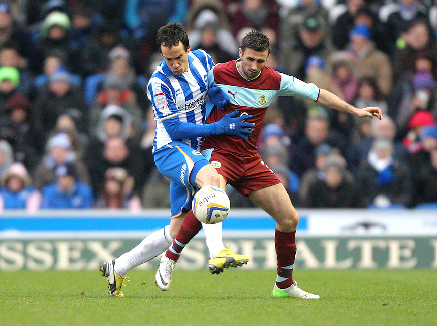 Brighton and Hove Albion's David Lopez battles with Burnley's Danny Lafferty ..Football - npower Football League Championship - Brighton and Hove Albion v Burnley - Saturday 23rd February 2013 - The AMEX Stadium - Falmer - Brighton..¨© CameraSport - 43 Linden Ave. Countesthorpe. Leicester. England. LE8 5PG - Tel: +44 (0) 116 277 4147 - admin@camerasport.com - www.camerasport.com