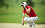 CHON BURI, THAILAND - FEBRUARY 16:  Meena Lee of South Korea lines up a putt on the 14th green during day one of the LPGA Thailand at Siam Country Club on February 16, 2012 in Chon Buri, Thailand.  Photo by Victor Fraile / The Power of Sport Images