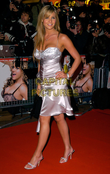 DANIELLE LLOYD.Attending I Want Candy Premiere, Vue West End, London, UK..March 20th, 2007.full length silver dress hands on hips diamante ruched shoes.CAP/CAN.©Can Nguyen/Capital Pictures