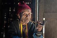 Woman smoking a pipe, Chin hills Myanmar