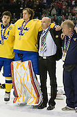 Magnus Paajarvi Svensson, Jacob Markstrom (Sweden - 25), Stefan Ladhe (Sweden - Assistant Coach), ? - Team Sweden celebrates after defeating Team Switzerland 11-4 to win the bronze medal in the 2010 World Juniors tournament on Tuesday, January 5, 2010, at the Credit Union Centre in Saskatoon, Saskatchewan.