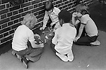 Playground games. South London junior school 1970s England . UK Boys playing with toy soldiers...