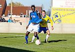 2015-11-01 / Voetbal / seizoen 2015-2016 / KSV Schriek - FC Mariekerke/ Jatta Assan (l. FC Mariekerke) met Kevin Damoiseau Foto: Mpics.be