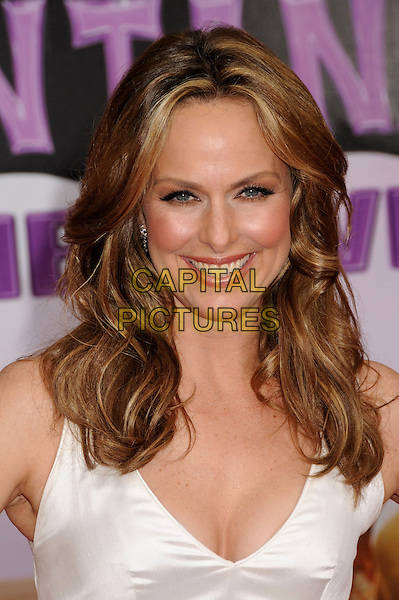 "MELORA HARDIN.""Hannah Montana: The Movie"" Los Angeles Premiere held at the El Capitan Theatre, Hollywood, CA, USA, .2nd April 2009. .portrait headshot cleavage white cream .CAP/ADM/BP.©Byron Purvis/Admedia/Capital PIctures"