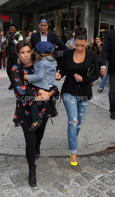 WWW.ACEPIXS.COM . . . . .  ....April 24 2012, New York City....Kim Kardashian (R) and Kourtney Kardashian take Kourtney's son Mason for a walk in the Meatpacking District on April 24 2012 in New York City....Please byline: CURTIS MEANS - ACE PICTURES.... *** ***..Ace Pictures, Inc:  ..Philip Vaughan (212) 243-8787 or (646) 769 0430..e-mail: info@acepixs.com..web: http://www.acepixs.com