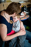 "A mother breastfeeding her toddler at a drop-in breastfeeding support centre.<br /> <br /> Image from the ""We Do It In Public"" documentary photography project collection: <br />  www.breastfeedinginpublic.co.uk<br /> <br /> Dorset, England, UK<br /> 17/04/2013"