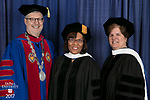 Left to right, the Rev. Dennis H. Holtschneider, C.M., president of DePaul, commencement speaker and honorary degree recipient Sharon Draper, a distinguished teacher and celebrated novelist, honorary degree recipient Sister Margaret Mary Fitzpatrick, S.C., president and CEO of St. Thomas Aquinas College in New York. DePaul University College of Education held its commencement ceremony, Saturday, June 10, 2017, at the Rosemont Theatre in Rosemont, IL. The Rev. Dennis H. Holtschneider, C.M., president of DePaul, conferred the degrees. (DePaul University/Jeff Carrion)