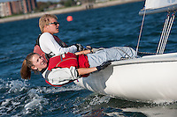 Catherine Corssen,'15, and Sean Beaulieu,'18, work together during the Salve Regina Sailing Team practice in the Newport Harbor.
