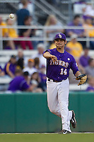 LSU Tigers third baseman Christian Ibarra #14 makes a throw to first base during the Southeastern Conference baseball game against the Georgia Bulldogs on March 22, 2014 at Alex Box Stadium in Baton Rouge, La. The Tigers defeated the Bulldogs 2-1. (Andrew Woolley/Four Seam Images)