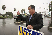 Tuesday, November 4 2008.  Rain fell early in San Diego on what is expected to be a record-breaking day at the polls.  City Attorney Michael Aguirre was soaking wet as he stood at the corner of Sunset Cliffs and Nimtz Blvd.  Ocean Beach Voters endure long lines and pouring rain beneath umbrellas as they wait to vote at the Ocean Beach Womens Club on Bacon Street.