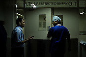 Dr. Devi Prasad Shetty (right) stops to take a phone call as he enters the Operation theatre at the Narayana Hrudayalaya in Bangalore, Karnataka, India. Photo: Sanjit Das/Panos