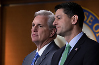 House Majority Leader Representative Kevin McCarthy, Republican of California, and Speaker of the House of Representatives Paul Ryan, Republican of Wisconsin, look on during a post Republican Caucus meeting press conference on Capitol Hill in Washington, DC on June 13, 2018. Credit: Alex Edelman / CNP /MediaPunch