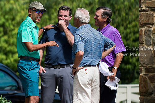United States President Barack Obama is greeted by unidentified golfers as he arrive to play a round of golf at Caves Valley Golf Club in Owings Mills, Maryland, U.S., on Saturday, Sept. 10, 2016.  Caves Valley is a members owned private club that has been rated among the top 50 of America's best modern courses by GolfWeek Magazine. <br /> Credit: Pete Marovich / Pool via CNP