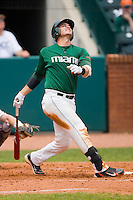 Yasmani Grandal #24 of the Miami Hurricanes hits a pop up against the Boston College Eagles at the 2010 ACC Baseball Tournament at NewBridge Bank Park May 27, 2010, in Greensboro, North Carolina.  The Eagles defeated the Hurricanes 12-10 in 10 innings.  Photo by Brian Westerholt / Four Seam Images