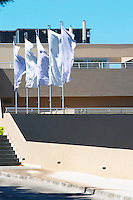 White flags flipping in the wind outside the luxury hotel Dubrovnik Palace. Uvala Sumartin bay between Babin Kuk and Lapad peninsulas. Dubrovnik, new city. Dalmatian Coast, Croatia, Europe.