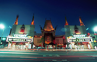 The facade of a Chinese Theatre at dusk. California.