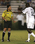05 October 2007: Duke's Christian Ibeagha (12) exchanges words with referee Roni Canales (left). Boston College defeated Duke University at Koskinen Stadium in Durham, North Carolina in an NCAA Men's soccer game.