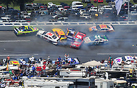 Apr 26, 2009; Talladega, AL, USA; NASCAR Sprint Cup Series drivers Mark Martin (5), Scott Riggs (36), Kevin Harvick (29), Jamie McMurray (26), Kasey Kahne (9), Jeff Gordon (24) and A.J. Allmendinger (44) crash during the Aarons 499 at Talladega Superspeedway. Mandatory Credit: Mark J. Rebilas-
