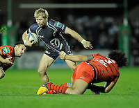 14th December 2013; Fionn Carr, Connacht, is tackled by Census Johnston, Toulouse. Heineken Cup Pool 3, round 4, Connacht v Toulouse, The Sportsground, Galway. Picture credit: Tommy Grealy/actionshots.ie.