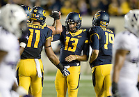 California teammates celebrate with Vincenzo D'Amato after D'Amato scored a field goal during the game against Northwestern at Memorial Stadium in Berkeley, California on August 31st, 2013.  Northwestern defeated CAL, 44-30.