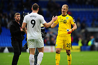 Sam Vokes and Joe Hart of Burnley celebrate at full time of the Premier League match between Cardiff City and Burnley at Cardiff City Stadium in Cardiff, Wales, UK. Sunday 30 September 2018