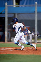 GCL Rays right fielder Diego Infante (17) follows through on a swing during a game against the GCL Twins on August 9, 2018 at Charlotte Sports Park in Port Charlotte, Florida.  GCL Twins defeated GCL Rays 5-2.  (Mike Janes/Four Seam Images)