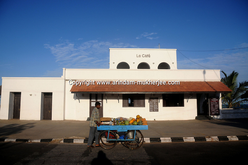 A fruit vendor in front of Le Cafe in Pondicherry. Le Cafe was the first French port in Pondicherry. Arindam Mukherjee/Sipa
