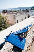 Castro Marina - Salento - Puglia - Listelli in legno usati per ristrutturare le barche prima della nuova stagione, appena ridipinte e lasciate ad asciugare al sole.