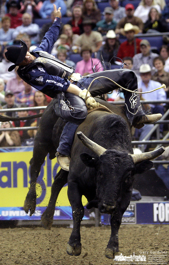 Paulo Crimber rides Cowboy Cut during the Professional Bull Riders' event Friday, Oct. 12, 2007, in Columbus, Ohio.